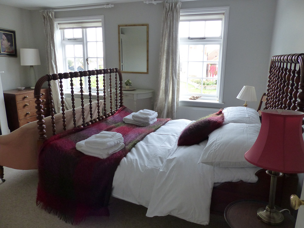 Double bedroom at Lorne cottage with view to sea