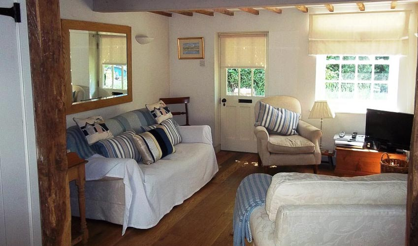 cosy sitting room with tv at September cottage