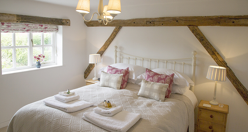 double bedroom at Cosy Dreadnought cottage