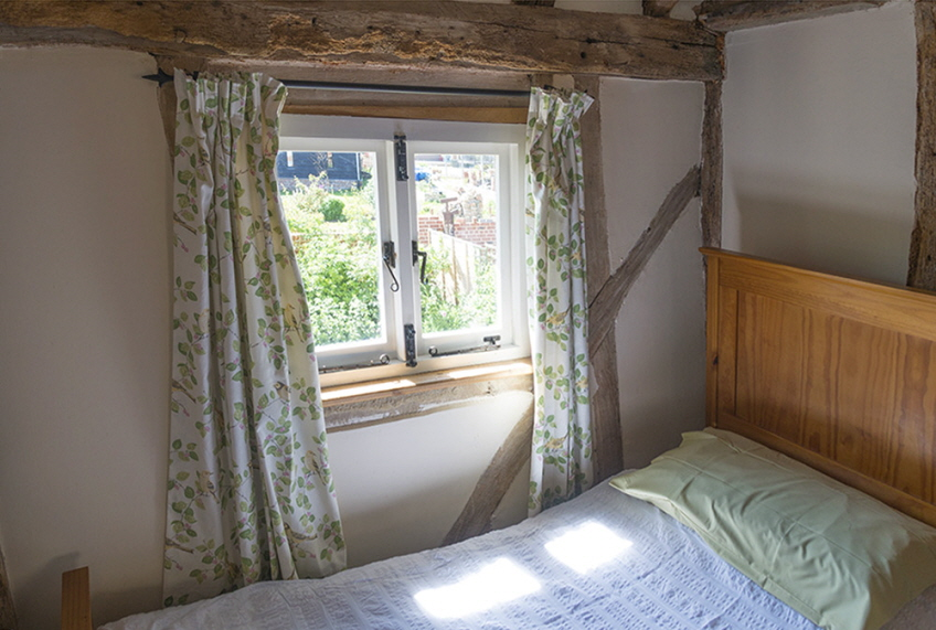 Comfortable twin bedroom at Leman Cottage, Suffolk