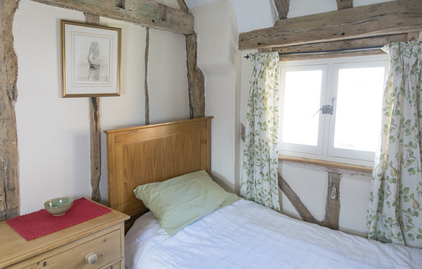 Sunny twin bedroom at Leman Cottage in Suffolk