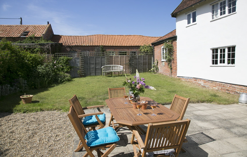 Sunny garden at Leman holiday cottage