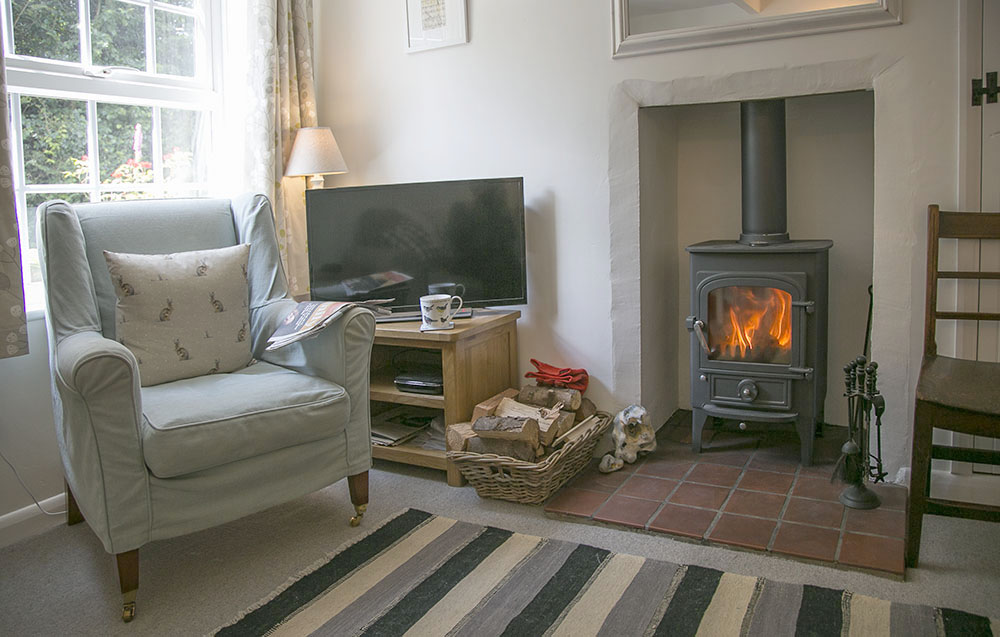 Comfortable sitting room and woodburner  at Eva's Cottage in Wenhaston