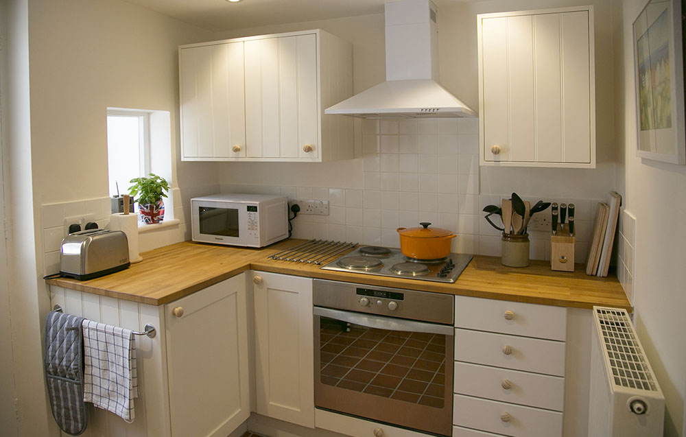 Well-equipped kitchen at Eva's holiday cottage in Suffolk